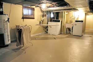 Unfinished basement tranformed into a laundry room